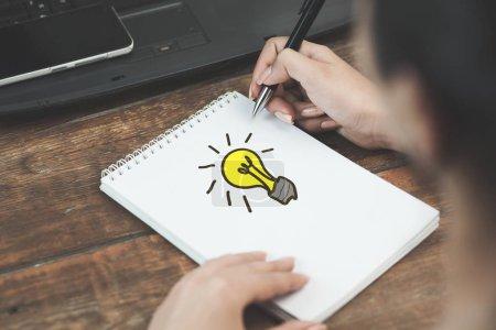 idea concept. Person drawing  bulb, education concept