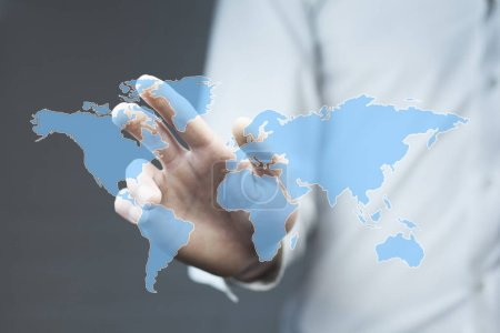 business man touching world map