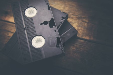 stack of video tape cassette over wooden background