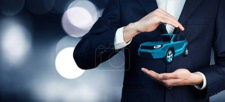 Car rental service concept. Businessman hand car
