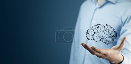 Photo for Businessman hand holding brain in palm - Royalty Free Image