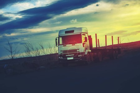 The big truck in way  at sunset
