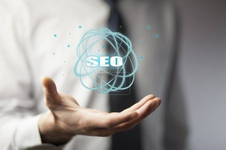 Business man holding SEO icon