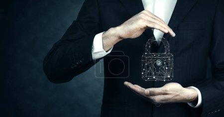 Businessman holding   padlock data center icon