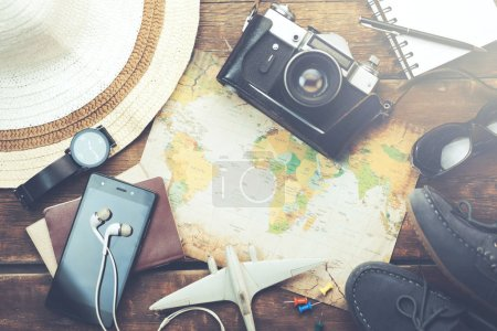 vacation items on wooden table
