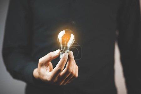 business man holding light bulb.  idea concept