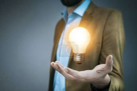 Photo for Idea concept. Hand of business man  light bulb - Royalty Free Image