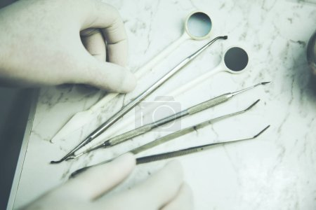 Photo for Disposable dental instruments. The concept of care for oral hygiene. - Royalty Free Image