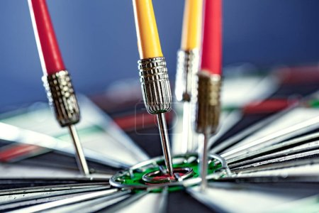 Photo for Arrow on center of dartboard - Royalty Free Image