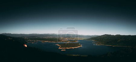 Photo for Panoramic view of mountains surrounding bay of water - Royalty Free Image