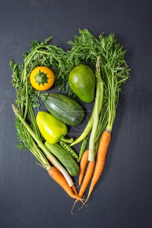 Photo for Fresh vegetables and fruits organized against black background - Royalty Free Image