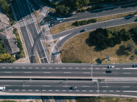 Aerial view of highway overpass at sunset light