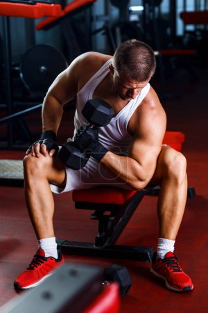 Photo for Young man exercising in the gym. - Royalty Free Image