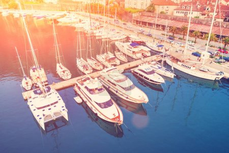 Top view of the yachts on a mooring in the sunlight