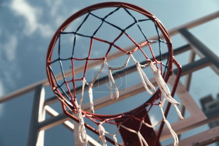 basketball hoop with net and sky on background