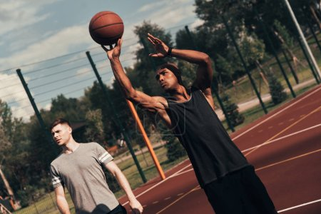 basketball team on arena outdoors playing, african man throwing ball