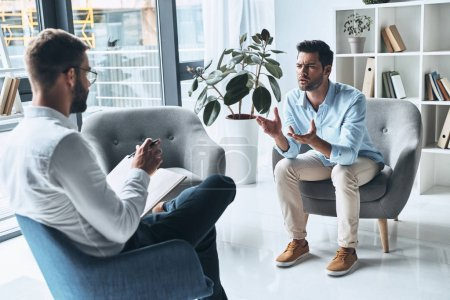 talking man having therapy session with psychologist