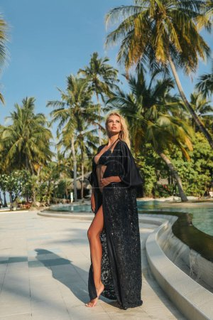 Photo for Fashion outdoor photo of beautiful sexy woman with blond hair in elegant swimming suit relaxing on paradise beach on Maldive island - Royalty Free Image