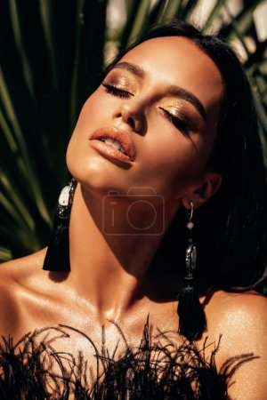 Photo for Fashion outdoor photo of sexy beautiful woman with dark hair in luxurious black cocktail dress posing in villa - Royalty Free Image