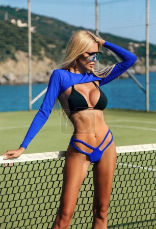 Photo for Fashion outdoor photo of beautiful sexy woman with blond hair in elegant swimming suit posing near open air swimming pool - Royalty Free Image