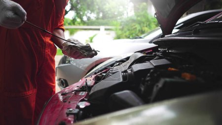 Photo for Mechanic repairing broken car - Royalty Free Image