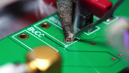 Photo for Engineer or technician repairing electronic circuit board with soldering iron - Royalty Free Image