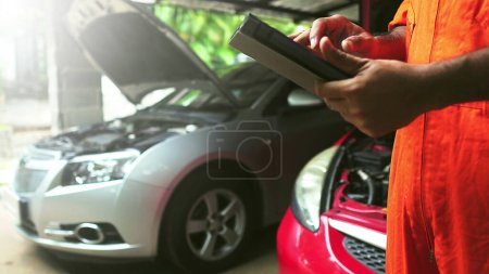 Photo for Mechanic using Diagnostic machine tools for car - Royalty Free Image