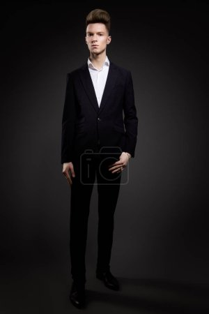 Photo for Portrait of handsome man in black suit on a black background - Royalty Free Image