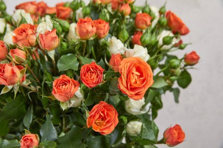 beautiful bouquet of orange and white roses