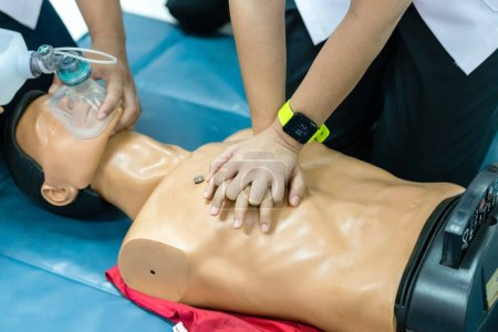 Photo for Basic Life Support of Demonstrating chest compressions on CPR doll - Royalty Free Image