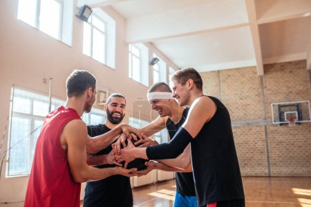 Basketball players holding the ball on the court.