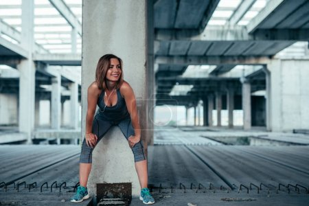 A young fit woman finishing her workout routine.