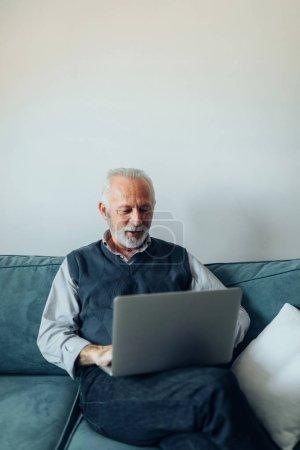 Elderly man using a laptop computer