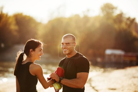 Photo for Athlete couple working out outdoors at sunset. - Royalty Free Image