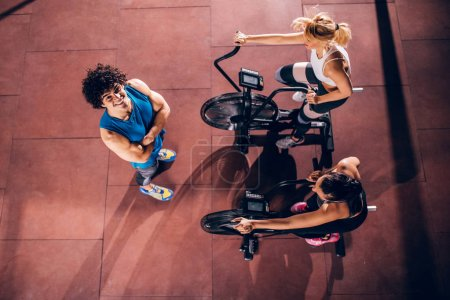 High angle shot of a group of people doing cardio in the gym.