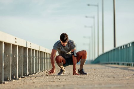 Photo for African american athlete man preparing for a workout outdoors. - Royalty Free Image