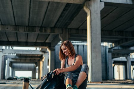 Photo for Photo of a smiling young woman preparing for a workout. - Royalty Free Image
