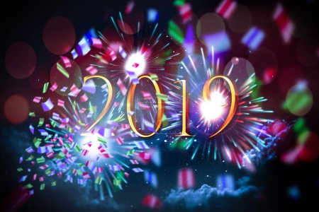 Photo for 2019 text on a background of fireworks, confetti, sparks and starry sky with clouds - new years eve poster - Royalty Free Image