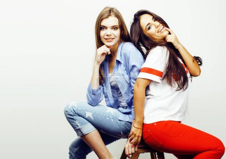 Photo for Best friends teenage girls together having fun, posing emotional on white background, besties happy smiling, lifestyle people concept, blond and brunette multi nations close up - Royalty Free Image