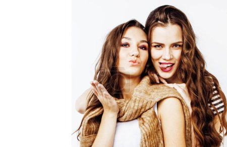 Photo for Two best friends teenage girls together having fun, posing emotional on white background, besties happy smiling, making selfie, lifestyle people concept close up - Royalty Free Image
