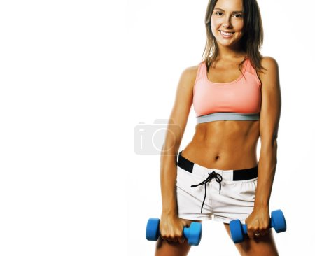 Photo for Young pretty slim woman with dumbbell isolated cheerful smiling - Royalty Free Image