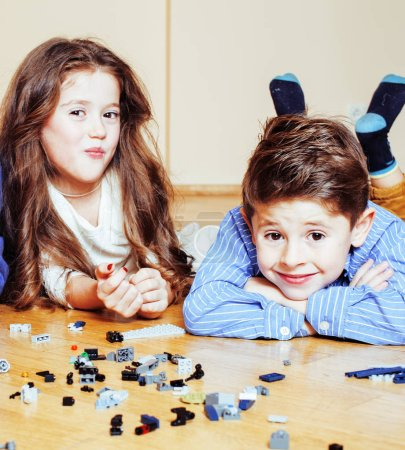 Photo for Funny cute children playing toys at home, boys and girl smiling, first education role close up, lifestyle people concept close up - Royalty Free Image