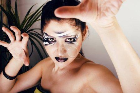 beauty young woman with creative make up like zebra closeup, wav