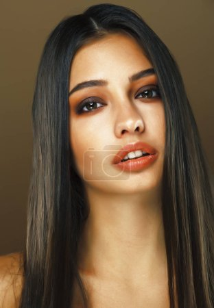 Photo for Young pretty indian girl posing emotional on brown background, lifestyle people concept, fashion makeup - Royalty Free Image