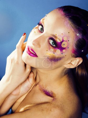 Photo for Beauty young woman with creative conceptual make up, mystery tinsel - Royalty Free Image