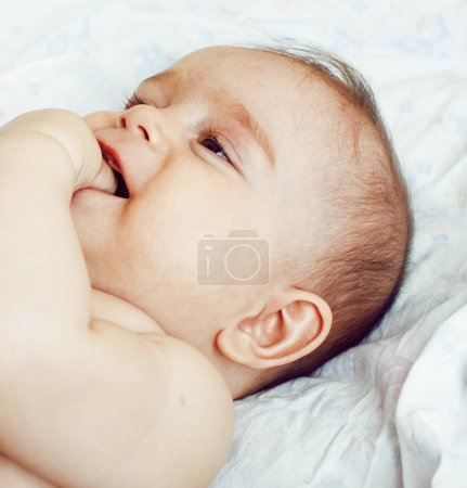 little cute baby toddler in bed close up smiling adorable cheerf