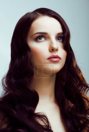 Photo for Young pretty brunette woman with hairstyle waves, luxury look fashion makeup close up - Royalty Free Image