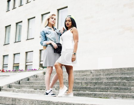 Photo for Two teenage girls infront of university building smiling, having fun traveling europe, lifestyle people concept close up - Royalty Free Image