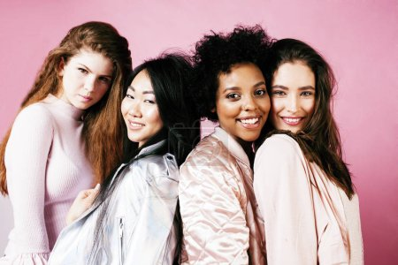 Photo for Different nation girls with diversuty in skin, hair. Asian, scandinavian, african american cheerful emotional posing on pink background, woman day celebration, lifestyle people concept close up - Royalty Free Image