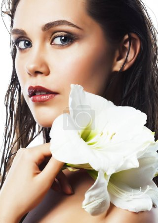 young pretty woman with Amarilis flower close up isolated on white, hands manicure, spa people concept